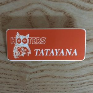 "Other - Hooters Girl uniform name tag says ""Tatayana"""